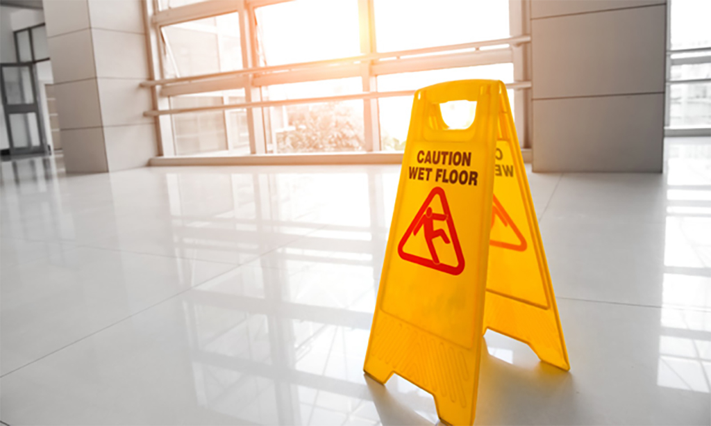 Wet floor with warning sign