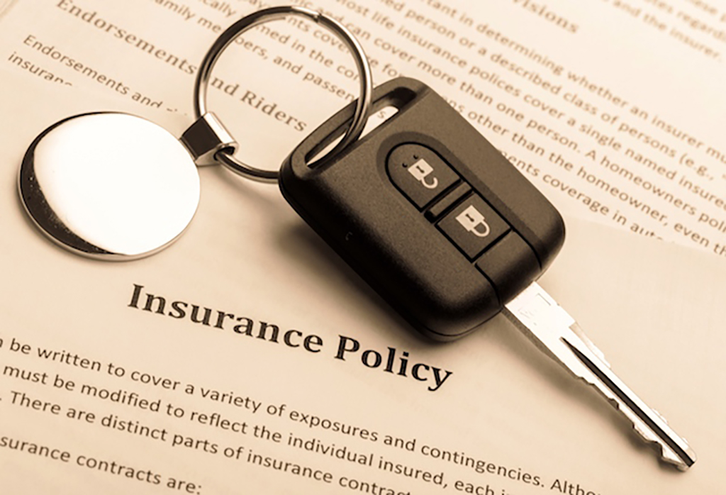 Image of key on top of insurance policy document
