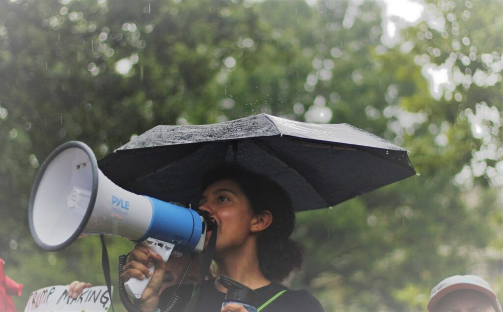 protester with megaphone